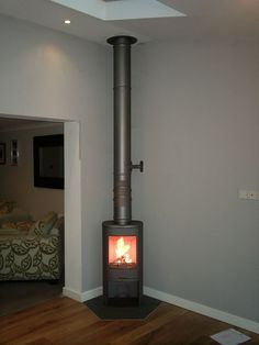 Corner Log Burner, Wood Burning Stove Corner, Corner Stove, Fireplace Logs, Living Room With Fireplace, Fireplaces, Shop Heater, Luxury Garden Furniture, Wood Burner