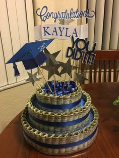 Graduation Money Cake - approx. $150 in singles, used the cricut to cut out the embellishments and cake topper...