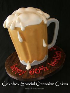 Beer mug cake on fondant faux wood board.