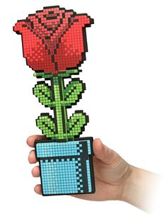 ThinkGeek :: 8-Bit Rose - I would crack up (and love it) if my husband gave me this for Valentine's Day.....Roses are #FF0000.  Violets are #0000FF. All my base are belong to you.