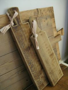 Wood cutting boards are perfect for entertaining. Use to sit appetizers or sandwiches on. Add a burlap bow for a Shabby Fabby look.