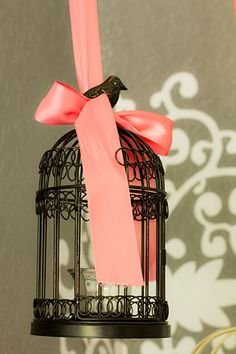 #Pink ribbon adds femininity to this #gray #nursery.   #hangingbirdcage