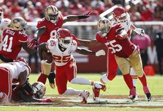 Harbaugh quiets critics, 49ers beat Chiefs 22-17 - Kansas City Chiefs running back Jamaal Charles (25) runs from San Francisco 49ers tight end Demarcus Dobbs (83) and linebacker Ahmad Brooks (55) during the second quarter of an NFL football game in Santa Clara, Calif., Sunday, Oct. 5, 2014. (AP Photo/Tony Avelar)