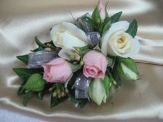 Wristlets made to order and is available in a wide range of colours. The flowers shown are as a guide only