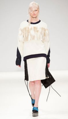 The Vogue Edit. 100% Wool and Cashmere jumper with contrasting marble faux fur panel by Jamie Wei Huang.