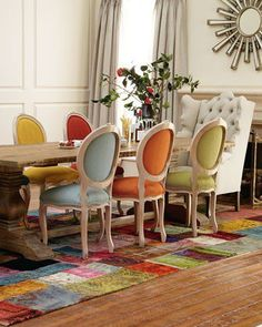 Lively dining chairs mimic the colors found in the rug. This patchwork of color is so uplifting! Love the fact that I always suggest starting with a rug to select a color scheme--this one certainly produced an interesting one!