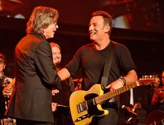 """How do you celebrate your birthday if you're Bruce Springsteen? By jumping on stage with palJackson Browne, apparently.  Tuesday, the day before the Boss turned 66, he attended Browne's show at Red Bank's Count Basie Theatre in his home state, New Jersey. Though Springsteenwatched most of the performance from the crowd, hejoined Browne on stage and together they performed a 12-minute version of """"Take It Easy,"""" which Browne co-wrotewith The Eagles' Glenn Frey in 1972..."""