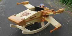 This baby's gonna grow up to do great things, like destroying Death Stars. Auckland-based craftsman Steve of 'Steves Wooden Toys' made a rocker inspired by