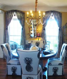 Black, white and yellow dining room-pineapple chairs.