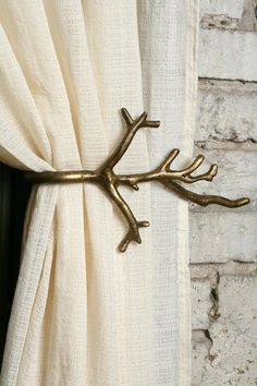 Gold tree branch curtain rod.