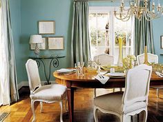 In this dining room, a color the designer calls St. Bart's aqua provides a dramatic backdrop for a merisier table and 1940s French chairs. (Photo: Photo: Jeff McNamara; Designer: Jan Showers)