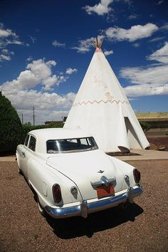 "Route 66 - A classic car parked outside a Wigwam at the famous Rt. 66 motel. ""The Fine Art Photography of Frank Romeo."""