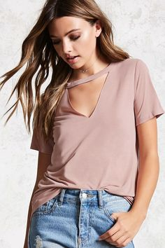 Style Deals - A knit tee featuring a round neckline, triangle cutout on the front, short sleeves, and a boxy silhouette.