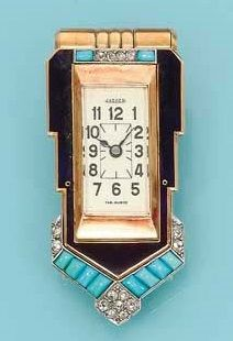 AN ART DECO ENAMEL AND TURQUOISE CLIP WATCH, BY JAEGER LECOULTRE. The rectangular-shaped cream dial with Arabic numerals and blued steel hands within a gold, blue enamel and buff-top turquoise surround with rose-cut diamond detail, mechanical movement, circa 1925, 4.2 cm long, with French assay marks for gold and platinum, in fitted red leather Cartier case. The dial signed Jaeger LeCoultre. www.vintageclothin.com