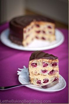 Layers of spiraling puff pastry tubes filled with Tart Cherry and Layered with Dulce de Leche Buttercream. This Honeycomb Cake will blow you away! by LetTheBakingBeginBlog.com #desserts #recipe