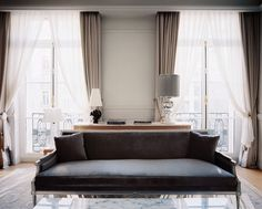 marble coffee table, drapes, shades of gray | Le Royal Monceau Hotel 1