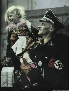 German soldier and his daughter----how could these monsters compartmentalize like this?