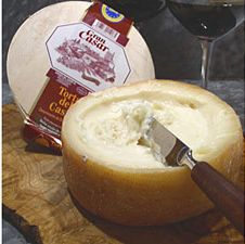 Torta del Casar is a sheep's milk cheese from the Extremadura region of western Spain. It has a delightfully soft creamy texture and a full and intense flavor with a hint of bitterness. Its name refers to its cake-like shape, akin to a Spanish potato omelet or tortilla. Torta del Casar has a light gamey, rustic, and somewhat smoky flavor. When ripe, the wheels of Torta can be sliced, or a hole can be cut in the top and the paste scooped out with a spoon or piece of crusty country bread.