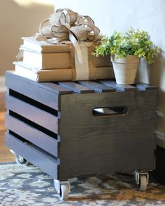 What a great DIY idea! Stain a wooden crate and add wheels.