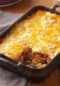 Roasted Turkey Enchilada Bake — Here's the easiest enchilada recipe ever, made with a mixture of leftover roasted turkey, salsa, black beans and corn and layered with tortillas and cheese.