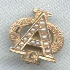 Alpha Phi Badge - 1920 - Chapter unknown. This badge features 13 pearls instead of 12. It also has channel set pearls and chasing on the Phi.