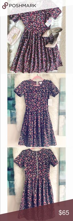 Gorgeous LulaRoe Amelia floral flare dress   Absolutely gorgeous LulaRoe Amelia flare floral dress in size M, this dress is so beautiful the material feels amazing on the skin and it's stretchy, super comfortable  color is pinkish red with navy and cream  LuLaRoe Dresses Midi