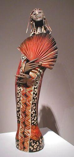 "Patricia C. Boyd, gourd art. ""Tribal Stand""."