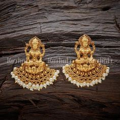 Designer antique earrings with lakshmi carving, beads and pearl hangings, plated with gold polish, made of copper alloy     #antique #earrings #jewellery #kushalsfashionjewellery Antique Earring 116579