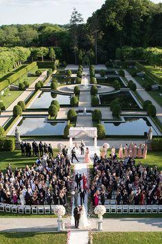 Ceremony at Oheka Castle | Photography: Brett Matthews Photography. Read More:  http://www.insideweddings.com/weddings/regal-outdoor-ceremony-ballroom-reception-at-oheka-castle-in-ny/821/