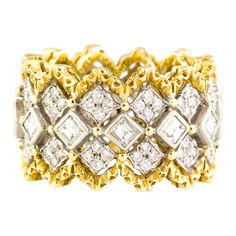 Intricate and impressive 18k white and yellow gold 3 row diamond band, by Buccellati. This wonderful band is made in the trademark Buccellati lattice structure design, which involves two highly ornate yellow gold ridges that encompass the 18K white gold and diamond set middle, and further with accented with small yellow gold beads. 21st century