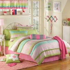I love the colors on this bedding. It would look great on light walls or with a cute blue accent wall. Bed, Bath & Beyond