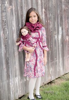 A beautiful and elegant dress for a true princess. The dreamy rose print and warm burgundy color ruffle details make this a chic and yet very comfortable dress for a special occasion. #Handmade by #LilliLovebird #matchingdressforgirlanddoll #AmericanGirl #matchingcuteness