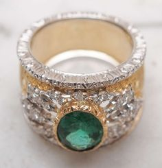 H D Diamonds is your direct contact to diamond trade suppliers, a Bond Street jeweller and a team of designers.www.handddiamonds... Tel: 0845 600 5557 - Mario Buccellati Emerald Ring image 3