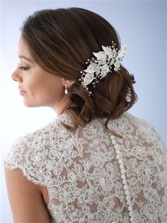 Fall 2016 Top Seller. Wedding hair clip features frosted and embellished leaves that glimmer under a cascade of hand-wired rhinestone branches.