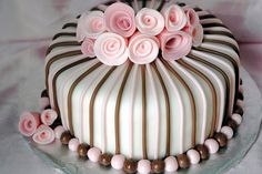 Pink And Brown Fondant Covered Cake.