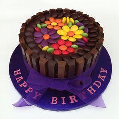Chocolate fudge Kitkat cake with minstrels, smarties and Cadburys pebbles birthday cake