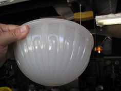 The opalescent glass shade out of the old dining car. This is how it looked after I removed all of that old paint.