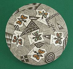 """Butterfly Get Together Seed Pot by Carolyn Concho, Acoma. Butterfly bunch preparing for the southward journey before the colder temperatures set in. This natural clay seed pot is dazzling, all hand-painted with natural paints. Each insect has a wing presented in three dimensions, lifted up and off the surface, so creative! About 6 1/4"""" in diameter and 2 1/8"""" tall."""