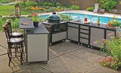 Kitchen, Comfortable And Elegant Swimming Pool In The Backyard With Prefab Outdoor Kitchen Kits With The Comfortable Design Ideas With Chairs And Some Beautiful Flowers And Plants: Building A Prefab Outdoor Kitchen Kits With The Comfortable Design Ideas Prefab Outdoor Kitchen, Outdoor Kitchen Kits, Modular Outdoor Kitchens, Outdoor Cooking Area, Outdoor Kitchen Countertops, Patio Kitchen, Outdoor Kitchen Design, Concrete Countertops, Kitchen Cart