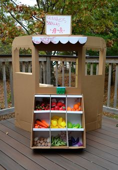 I have been searching for a great idea for the daycare to make a store out of cardboard boxes and I like this one!