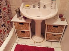Bathroom storage - use small storage cabinets keep supplies neat under a pedestal sink.