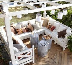 Seating under a pergola. How pretty! I would want vines growing on the pergola though to give shade & soften the lines.