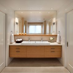 I really like the floating cabinets in the bathroom