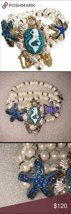 Betsey Johnson Nautical bracelet Selling to buy betsey pieces I need. This is from the nautical collection. The bracelet is stranded with faux pearls. Each side has a starfish with encrusted rhinestones. The center has a mermaid portrait. Rare Nwot Betsey Johnson Jewelry Bracelets