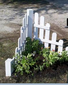 Home talk!  Mail box garden out of old pallets  look at Pam's mailbox in Marietta...love the little bit of picket fence
