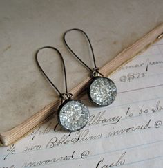 Sparkle Glass Button Earrings Upcycled Jewelry Long Arched Earwires Shine on by ThatOldBlueHouse2 on Etsy https://www.etsy.com/listing/246706045/sparkle-glass-button-earrings-upcycled