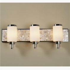 """Mother of Pearl Bath Light - 3 light  Three lights, a sleek chrome backplate and the distinctive beauty of mother of pearl create a natural oasis in any bathroom. (8""""Hx26""""Wx6""""D) Only hangs as shown. Frosted opal glass shades measure: 6""""Hx3.5""""W 3x100 watts (medium base socket). UL for damp location. Backplate measurements: 25 """" wide X 5"""" high."""