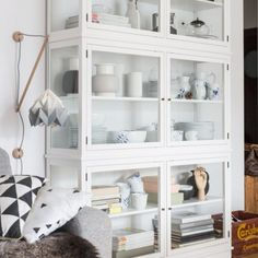 Simple white glass cabinet in the scandinavian styled interior.