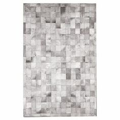 Cowhide rug with a four-inch square patchwork motif.  Product: RugConstruction Material: CowhideColor: GreyDimensions: 5' x 8'Note: Size is approximate. Please be aware that actual colors may vary from those shown on your screen. Accent rugs may also not show the entire pattern that the corresponding area rugs have.Cleaning and Care: Clean with dry cloth