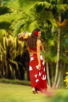 Beautiful Polynesian woman walk wearing a red pareo